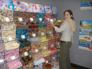 Elysha, gathering her candy