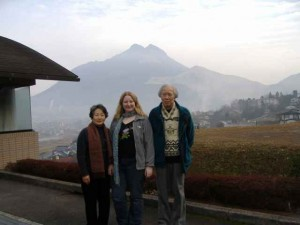 Naoko, Hirosuke & I, standing by Yufu Mountain in Yufuin