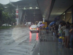 People waiting to catch a train in amongst the typhoon