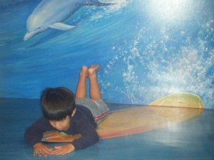 You can see the 3D-ness of this photo - the painting goes from the wall down to the floor, this kid was taking advantage of the situation!